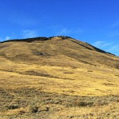 This peaks sits on the western edge of the City of Rocks National Preserve. The route climbs up the open slopes.