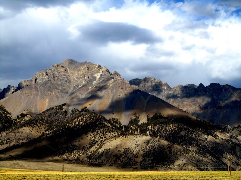 Paragon Peak is the peak hiding behind Lost River Mountains flank as viewed from US-93. George Reinier Photo