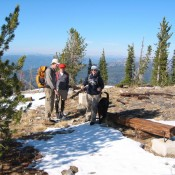 The summit of Boulder Mountain with three hikers and the sketchy remains of the fire lookout. John Platt Photo