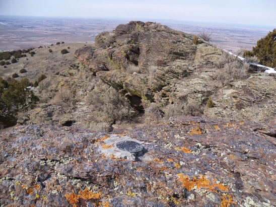 Summit view NW to Snake River and the Burley area, 3/5/13. In place, a US Coast & Geodetic Survey benchmark tablet stamped 'Declo' and dated 1950. On the side of this mountain overlooking Declo High School is a large painted letter 'D'. Rick Baugher Photo