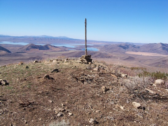 On top, a USGS benchmark tablet stamped 'Enoch' and dated 1948. View W to Blackfoot Reservoir and the Putnams, 10/24/13. Rick Baugher Photo