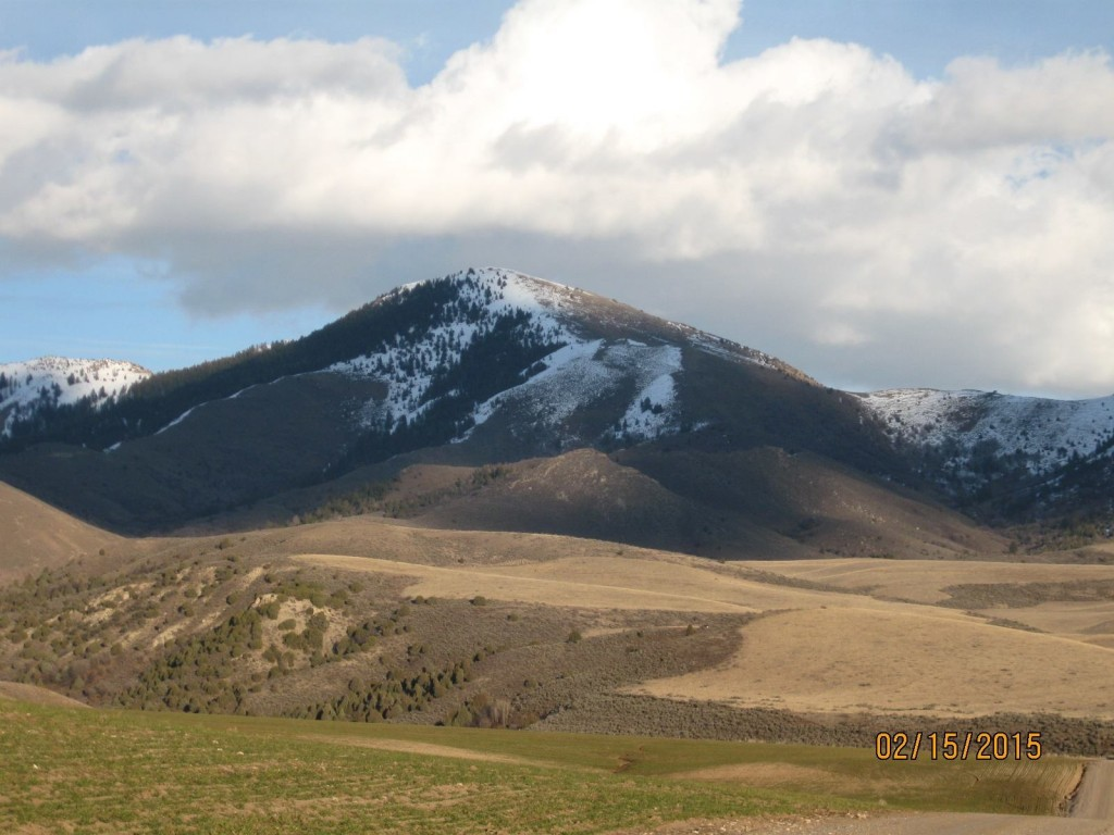 Cottonwood Peak in the southern Portneuf Range from the old pioneer Grant Ward cemetery east of Downey Idaho. Russ Durant Photo