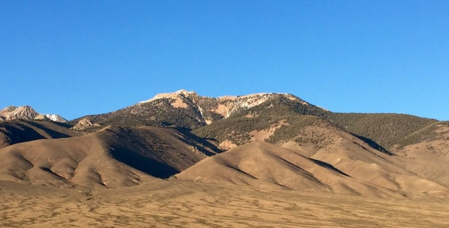 """Sunny Bar Peak viewed from the west. The Rocky Run drainage is the """"V"""" shaped canyon just left of center."""