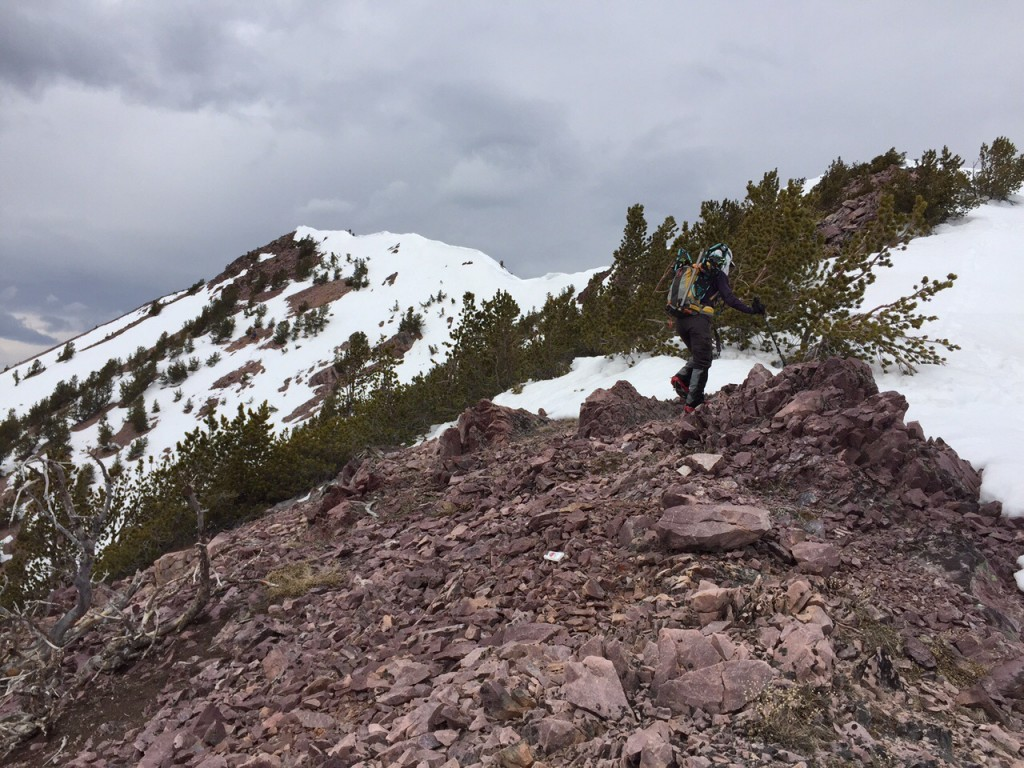 The majority of the traverse is on a broad forest ridge. Just ahead of this climber is where the ridge narrows down and becomes a bit more challenging.