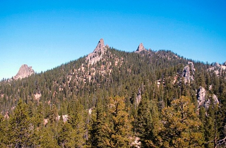 Needles Peak from the southwest. Three of the granite towers on this peak are visible in this photo. There are a large number of one and two pitch routes on these formation many of which were first climbed by Doug Colwell.