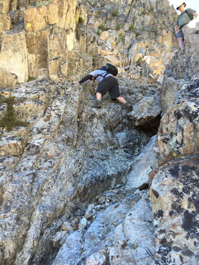 Dan Robbins climbing the Crux.