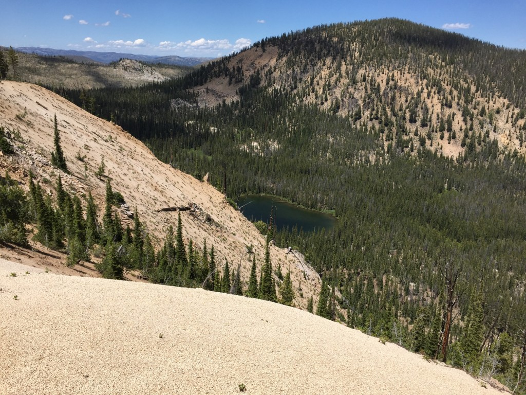 Around 8,000 feet the east ridge narrows. This photo shows an unnamed lake nestled into the ridge's north side.
