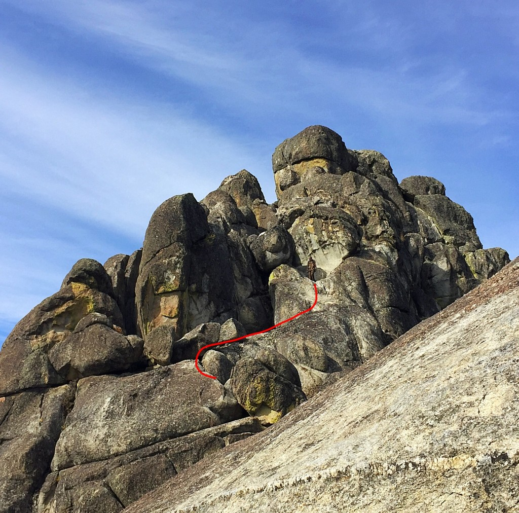 The third section of the route climbs up, first to the right, then back to the base of the large bulging rock shown here.