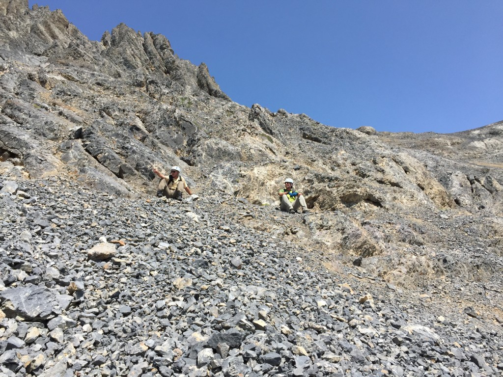 Taking a break at the point where the route leaves the talus and starts climbing talus covered slabs.