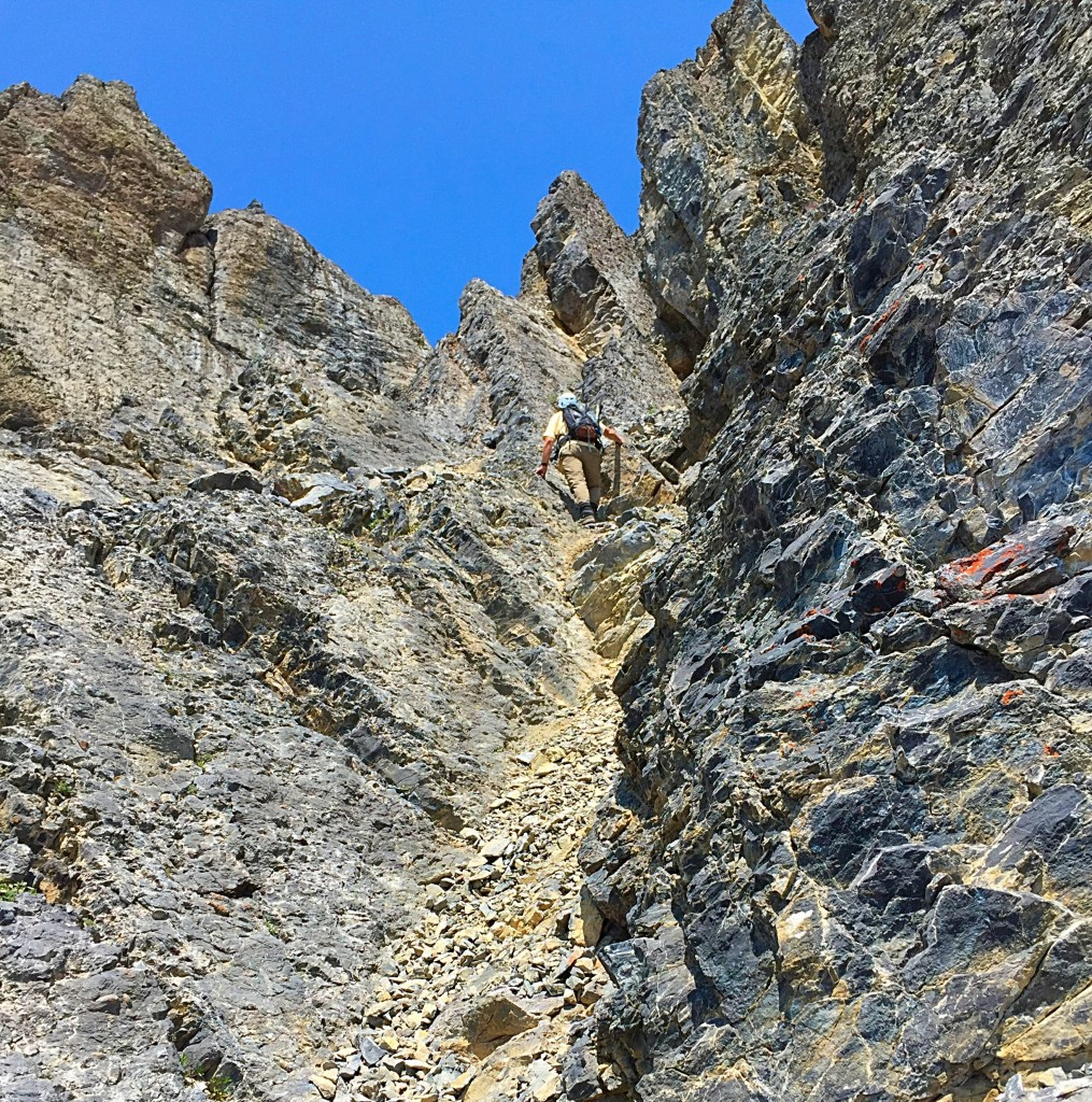 Larry Prescott mid-way up the gully. He is getting ready to move to his left where the rock is slightly less fractured.