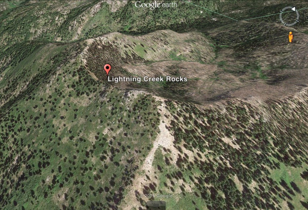 This Google Earth image shows the high point identified as Lightning Creek Rocks. Why is a mystery to me.